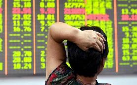 Новый обвал на фондовом рынке КНР потянул вниз индексы Азии и Австралии