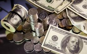 Эксперты: повышение ставки ФРС США может стабилизировать рубль
