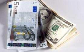 Курс доллара достиг 77 рублей, евро — 84