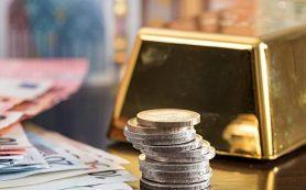 Золото дорожает на ослаблении доллара и росте спроса на безопасные активы
